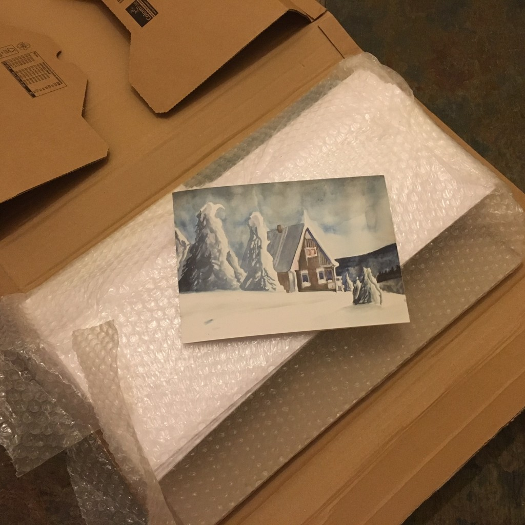 Christmas cards in bubble wrap and cardboard box