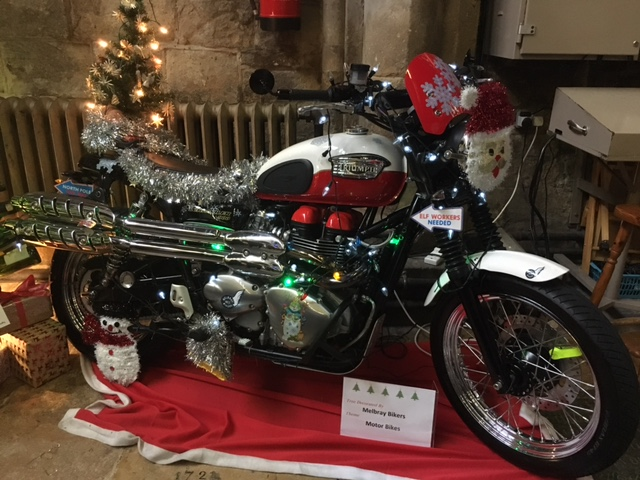 Triumph motorbike decorated with Christmas decorations