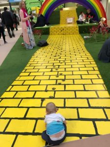 baby sitting at the start of the yellow brick road